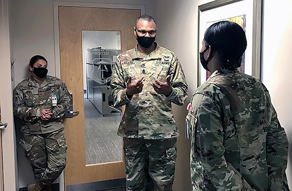 Army Command Sgt. Maj. Michael Gragg (center), senior enlisted leader at the Defense Health Agency, mentors airmen at Joint Base Langley-Eustis in Hampton, Virginia, Sept. 23, 2020.