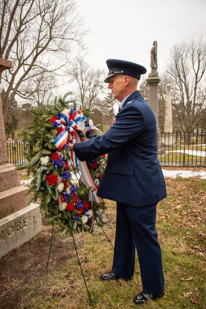 Col. Steven Hefferon, commander of the 107th Mission Support Group, Niagara Falls Air Reserve Station, New York Air National Guard, presents a wreath at the grave of Millard Fillmore, the 13th president, in Buffalo, N.Y., Jan. 7, 2021. The 107th Attack Wing has been honoring the former president with a wreath-laying each year on his birthday for more than 30 years.