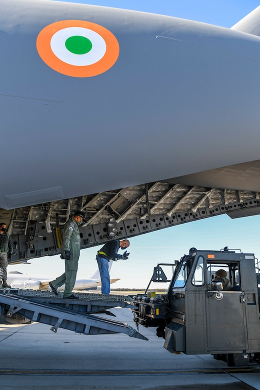 A member of the 436th Aerial Port Squadron guides a K-loader onto the ramp of an Indian air force C-17 Globemaster III Nov. 20, 2020, at Dover Air Force Base, Delaware. Dover AFB annually supports $3.5 billion worth of FMS operations due to its strategic location and 436th Aerial Port Squadron, the largest aerial port in the Department of Defense. The United States and India have shared interests in promoting global security, stability and economic prosperity. (U.S. Air Force photo by Senior Airman Christopher Quail)