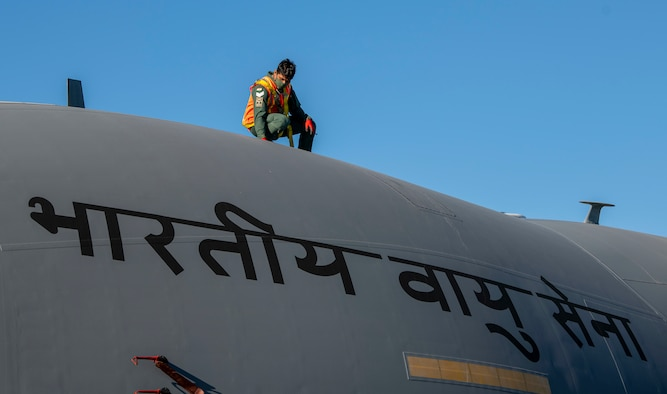 A member of the Indian air force 28th Wing inspects an Indian air force C-17 Globemaster III at Dover Air Force Base, Delaware, Nov. 20, 2020. Dover AFB annually supports $3.5 billion worth of FMS operations due to its strategic location and 436th Aerial Port Squadron, the largest aerial port in the Department of Defense. The United States and India have shared interests in promoting global security, stability and economic prosperity. (U.S. Air Force photo by Senior Airman Christopher Quail)
