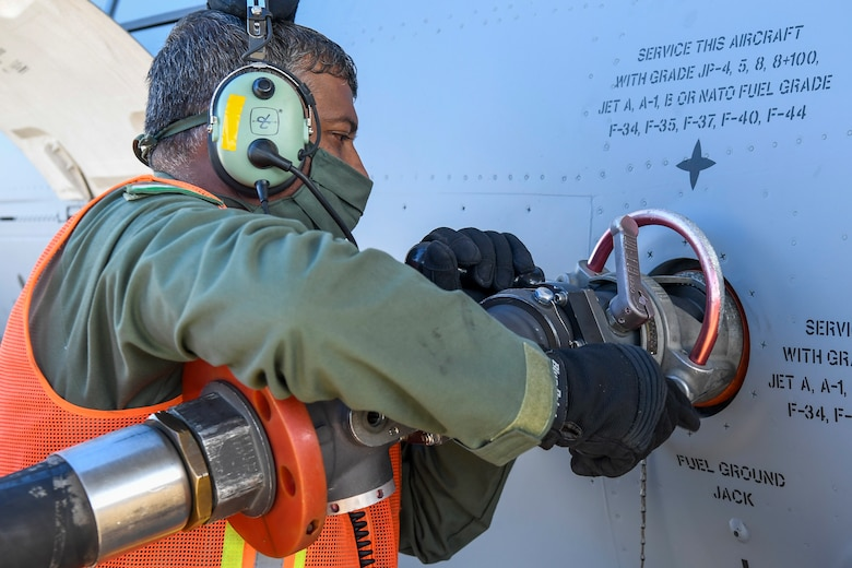 A member of the Indian air force 28th Wing attaches a fuel hose to an Indian air force C-17 Globemaster III at Dover Air Force Base, Delaware, Nov. 20, 2020. Dover AFB annually supports $3.5 billion worth of FMS operations due to its strategic location and 436th Aerial Port Squadron, the largest aerial port in the Department of Defense. The United States and India have shared interests in promoting global security, stability and economic prosperity. (U.S. Air Force photo by Senior Airman Christopher Quail)
