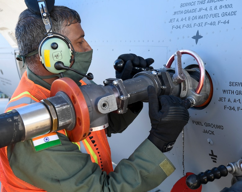 A member of the Indian air force 28th Wing attaches a fuel hose to an Indian air force C-17 Globemaster III at Dover Air Force Base, Delaware, Nov. 20, 2020. The U.S. strengthens its international partnerships through foreign military sales. Dover AFB actively supports $3.5 billion worth of FMS due to its strategic location and 436th Aerial Port Squadron, the largest aerial port in the Department of Defense. As the world's oldest and largest democracies, the United States and India share a commitment to freedom, human rights and rule of law. (U.S. Air Force photo by Senior Airman Christopher Quail)