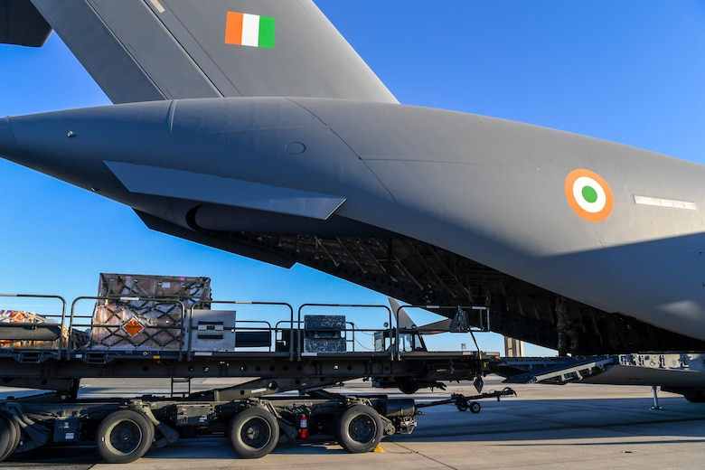 Airmen from the 436th Aerial Port Squadron prepare to load cargo onto an Indian air force C-17 Globemaster III Nov. 20, 2020, at Dover Air Force Base, Delaware. The U.S. strengthens its international partnerships through foreign military sales. Dover AFB actively supports $3.5 billion worth of FMS due to its strategic location and 436th Aerial Port Squadron, the largest aerial port in the Department of Defense. As the world's oldest and largest democracies, the United States and India share a commitment to freedom, human rights and rule of law. (U.S. Air Force photo by Senior Airman Christopher Quail)