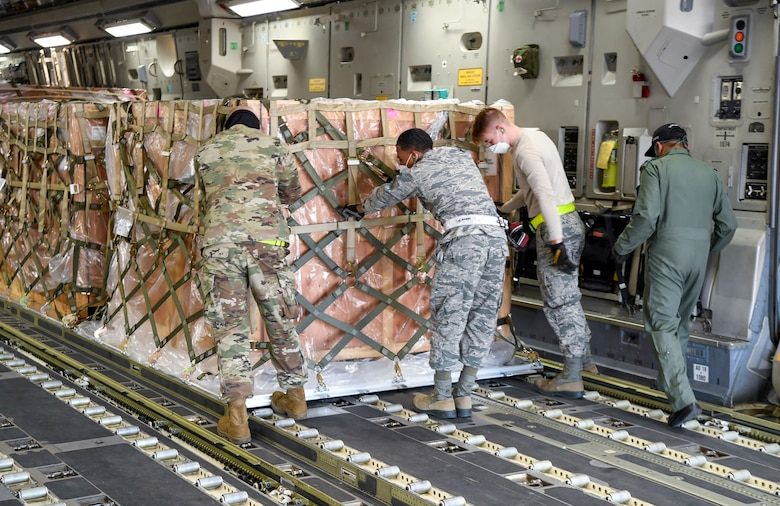 Airmen from the 436th Aerial Port Squadron move cargo onto an Indian air force C-17 Globemaster III at Dover Air Force Base, Delaware, Nov. 20, 2020. The U.S. strengthens its international partnerships through foreign military sales. Dover AFB actively supports $3.5 billion worth of FMS due to its strategic location and 436th Aerial Port Squadron, the largest aerial port in the Department of Defense. As the world's oldest and largest democracies, the United States and India share a commitment to freedom, human rights and rule of law. (U.S. Air Force photo by Senior Airman Christopher Quail)