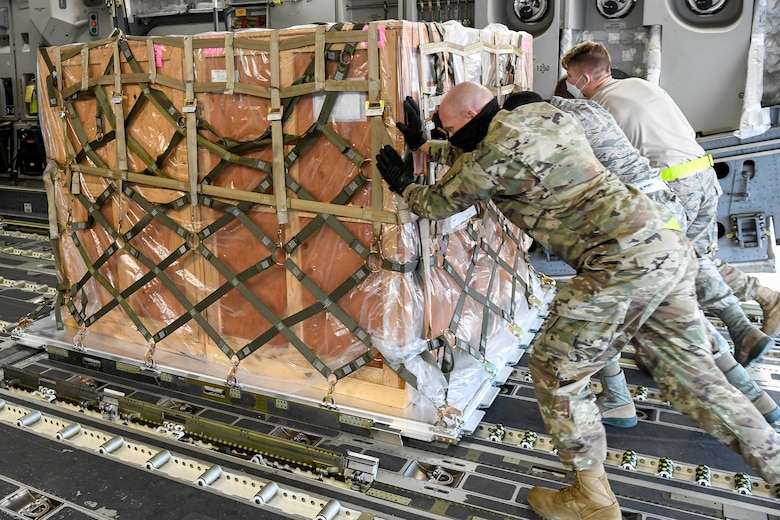 Airmen from the 436th Aerial Port Squadron load cargo onto an Indian air force C-17 Globemaster III at Dover Air Force Base, Delaware, Nov. 20, 2020. The U.S. strengthens its international partnerships through foreign military sales. Dover AFB actively supports $3.5 billion worth of FMS due to its strategic location and 436th Aerial Port Squadron, the largest aerial port in the Department of Defense. As the world's oldest and largest democracies, the United States and India share a commitment to freedom, human rights and rule of law. (U.S. Air Force photo by Senior Airman Christopher Quail)