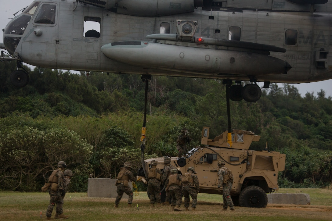 U.S. Marines with Combat Logistics Battalion 31, 31st Marine Expeditionary Unit (MEU) attach a Joint Light Tactical Vehicle Heavy Guns Carrier to a Marine CH-53E Super Stallion aircraft assigned to Marine Medium Tiltrotor Squadron 262 (Reinforced), 31st MEU, during a Helicopter Support Team (HST) training exercise as part of MEU Exercise at Kin Blue, Okinawa, Japan on Dec. 17, 2020. HST training is conducted to increase proficiency in logistics tasks and enhance the ability to execute potential contingency missions carried out by the 31st MEU. The 31st MEU, the Marine Corps only continuously forward-deployed MEU, provides a flexible and lethal force ready to perform a wide range of military operations as the premiere crisis response force in the Indo-Pacific region. (U.S. Marine Corps photo by Lance Cpl. Colton Nicks)