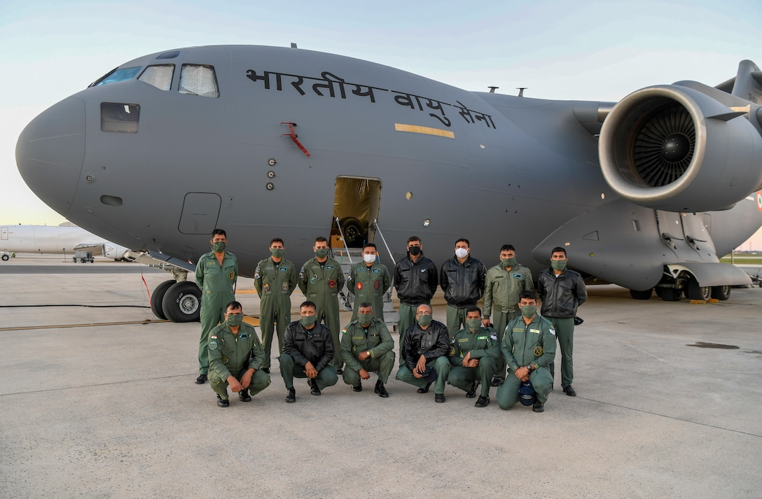 Indian Air Force 28th Wing members pose for a group photo at Dover Air Force Base, Delaware, Nov. 20, 2020. The U.S. strengthens its international partnerships through foreign military sales. Dover AFB actively supports $3.5 billion worth of FMS due to its strategic location and 436th Aerial Port Squadron, the largest aerial port in the Department of Defense. As the world's oldest and largest democracies, the United States and India share a commitment to freedom, human rights and rule of law. (U.S. Air Force photo by Senior Airman Christopher Quail)