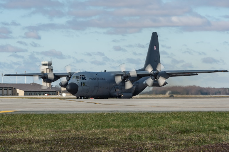 As part of a foreign military sales mission, a Polish air force C-130E Hercules taxis to a parking spot after landing to be unloaded by Airmen from the 436th Aerial Port Squadron Dec. 17, 2020, at Dover Air Force Base, Delaware. The United States and Poland have enjoyed warm bilateral relations since 1989. Poland is a stalwart NATO ally, and both the U.S. and Poland remain committed to the regional security and prosperity of Europe. Due to its strategic location, Dover AFB supports approximately $3.5 billion worth of foreign military sales annually. (U.S. Air Force photo by Roland Balik)