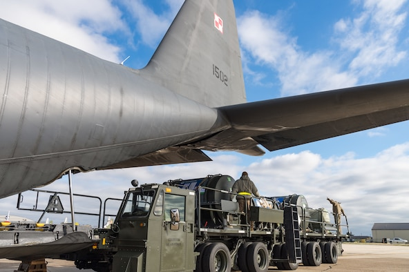 Airmen from 436th Aerial Port Squadron secure pallets on a cargo loader after unloading a Polish air force C-130E Hercules Dec. 17, 2020, at Dover Air Force Base, Delaware, as part of a foreign military sales mission. The United States and Poland have enjoyed warm bilateral relations since 1989. Poland is a stalwart NATO ally, and both the U.S. and Poland remain committed to the regional security and prosperity of Europe. Due to its strategic location, Dover AFB supports approximately $3.5 billion worth of foreign military sales annually. (U.S. Air Force photo by Roland Balik)