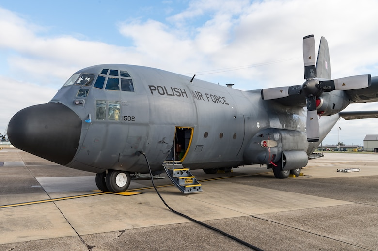 A Polish air force C-130E Hercules is parked on the flight line after delivering cargo Dec. 17, 2020, at Dover Air Force Base, Delaware, as part of a foreign military sales mission. The United States and Poland have enjoyed warm bilateral relations since 1989. Poland is a stalwart NATO ally, and both the U.S. and Poland remain committed to the regional security and prosperity of Europe. Due to its strategic location, Dover AFB supports approximately $3.5 billion worth of foreign military sales annually.  (U.S. Air Force photo by Roland Balik)