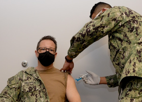 Rear Adm. Joseph A. DiGuardo Jr., commander, Navy Expeditionary Combat Command, receives the COVID-19 vaccine at Sewells Point Branch Medical Clinic in Norfolk, Va.