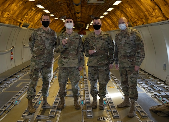 U.S. Air Force Col. Zachery Jiron, left, 60th Air Mobility Wing vice commander, and Chief Master Sgt. Robert Schultz, right, 60th AMW command chief, recognize Senior Airman Schuyler Dolton, second left, 660th AMXS Instrument flight control system journeyman, and Senior Airman Nikolas McEssey, 660th Aerial Maintenance Squadron flying crew chief, as star performers during Leadership Rounds Jan. 8, 2021, at Travis Air Force Base, California. The Leadership Rounds program provides 60th AMW leadership an opportunity to interact with Airmen and receive a detailed view of each mission performed at Travis AFB. (U.S. Air Force photo by Senior Airman Cameron Otte)