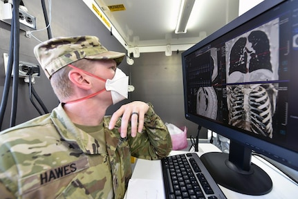 Sgt. Michael Hawes, a 68P radiology specialist assigned to Madigan Army Medical Center at Joint Base Lewis-McChord, Washington, reviews 3D images from the new deployable CT scanner. Such detailed images are an upgrade to current systems, providing Army medical personnel better tools to treat patients in the field.