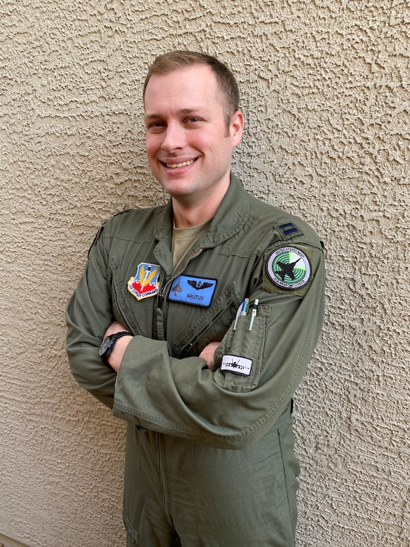 A captain poses for a photo.