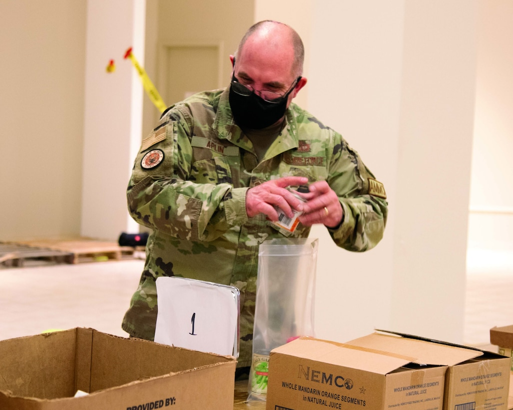 U.S. Air Force Senior Master Sgt. Timothy Aplin, assigned to the Michigan National Guard's COVID-19 response task force, is working at the Greater Lansing Food Bank, Lansing, Michigan, Jan. 6, 2021. He is one of five service members assigned to the food bank helping to distribute food to schoolchildren.