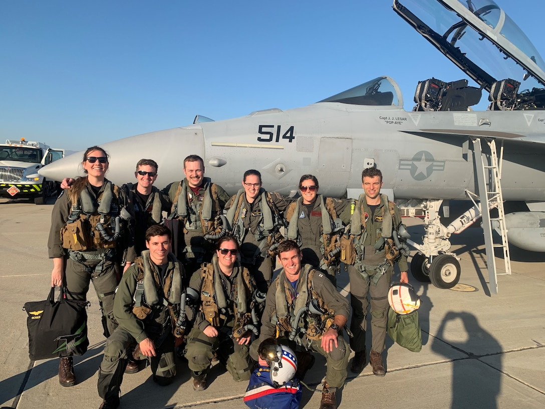 "U.S. Air Force Capt. Aaron ""Brutus"" Tindall, 390th Electronic Combat Squadron EA-18G weapons officer, poses with naval aircrew and electronic warfare officers Oct. 29, 2020, at the Point Mugu Naval Air Station, California. Tindall is the first Airman to graduate from the Navy's Airborne Electronic Attack weapons school, making him a subject matter expert in AEA and the EA-18G Growler."