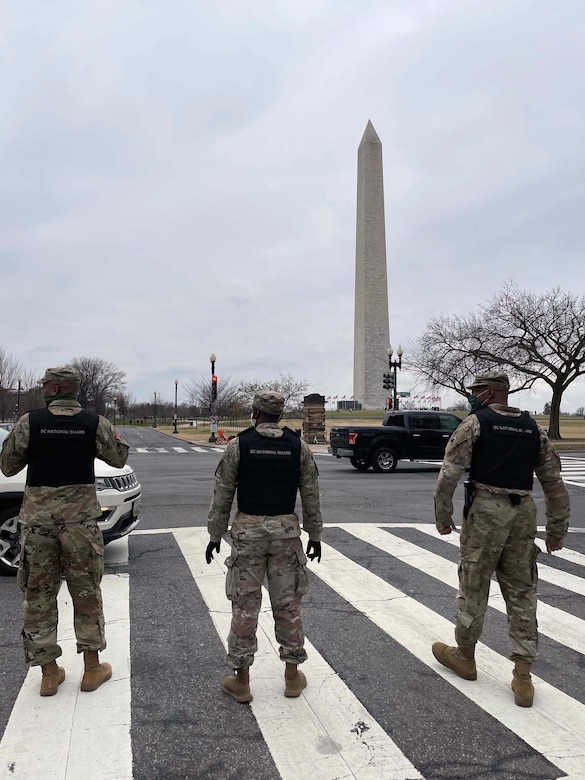 DC National Guard members stand in front of a monument in Washington, D.C on January 5, 2021. The District of Columbia National Guard activated several hundred personnel to support the city government during expected demonstrations. (D.C. National Guard photo by Staff Sgt. Anthony Small)