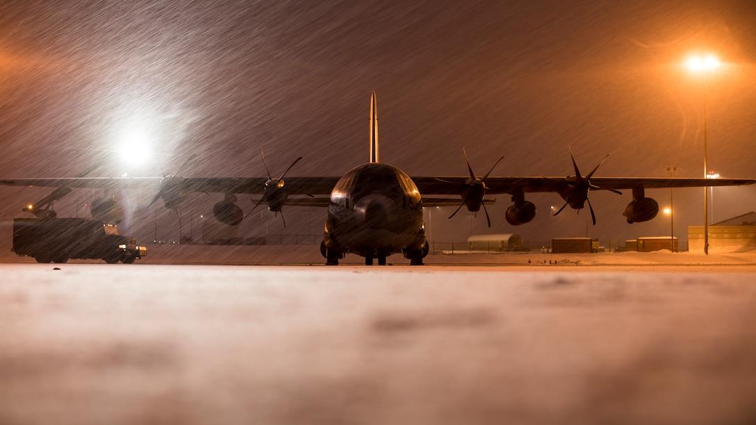 U.S. Marines de-ice a Marine KC-130J Super Hercules aircraft before takeoff from Joint Base Elmendorf-Richardson, Alaska, Dec. 9.