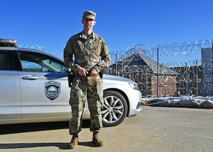 New Hampshire National Guard 1st Lt. James Lawrence, a military police officer with the 237th Military Company, with his issued patrol car on the perimeter of the N.H. State Prison for Men in Concord, N.H., on Jan. 10, 2021. Lawrence is one of 20 Guard members filling in at the prison due to a shortage of corrections officers caused by COVID-19.