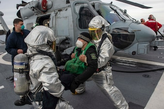 Sailors conduct a crash and salvage drill aboard USS Vella Gulf (CG 72).