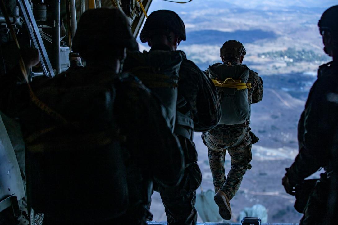 U.S Marines static line jump from a KC-130J Hercules over Drop Zone Basilone on Marine Corps Base Camp Pendleton, Calif., Dec. 10.