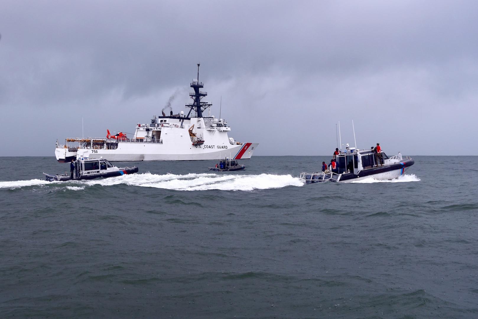 Guyana coast guard small boats patrol alongside the USCGC Stone (WMSL 758) off Guyana's coast on Jan. 9, 2021.