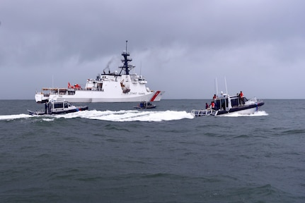 Guyana coast guard small boats patrol alongside the USCGC Stone (WMSL 758) off Guyana's coast on Jan. 9, 2021.