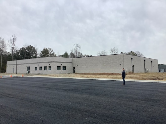 IMAGE: DAHLGREN, Va. (Jan. 11, 2021) - Facility Manager David Powers points out the recently completed electromagnetics integration facility.  The facility will house 50 personnel specialized in Electromagnetic Environmental Effects, including modern computer stations, a laboratory, and team meeting rooms.  (U.S. Navy photo/Released)