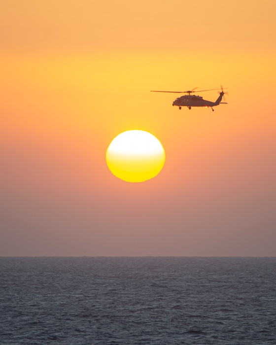 """An MH-60S Sea Hawk helicopter, attached to the """"Dragon Slayers"""" of Helicopter Sea Combat Squadron (HSC) 11, conducts flight ops near the aircraft carrier USS Harry S. Truman (CVN 75) over the Arabian Sea Jan. 27, 2020."""