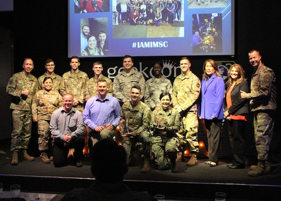 All 2020 AFIMSC Innovation Rodeo teams pose for a group photo with AFIMSC Commander Maj. Gen. Tom Wilcox and AFIMSC Command Chief Master Sgt. Edwin Ludvigsen Feb. 7, 2020.