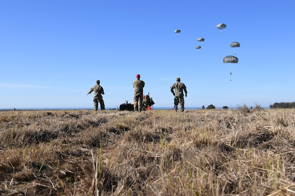 Soldiers assigned to the 346th Theater Aerial Delivery Company, an Army Airborne unit, and Marines, assigned to the 3rd Brigade, 3rd Air Naval Gunfire Liaison Company, Marine Forces Reserve, participate in tactical, low-level, static line parachute insertion operation training Jan. 9, 2021, at Vandenberg Air Force Base, Calif.