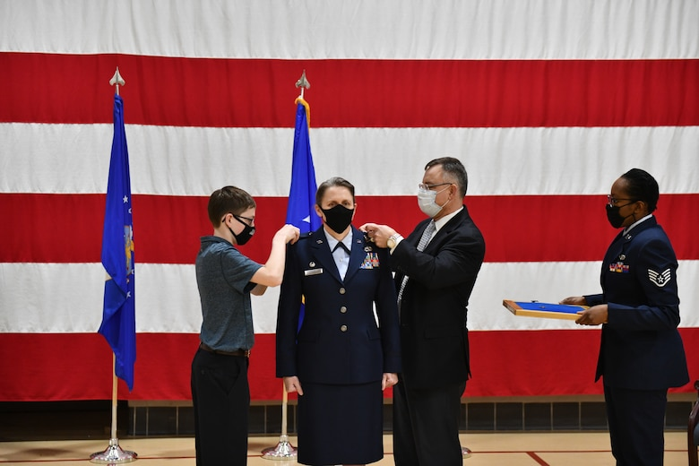 New York Air National Guard Brig.Gen. Denise Donnell's son Max Szczesny, and her husband Greg Szczensny, pin her general's star on during promotion ceremonies held on Wednesday, Jan. 6, 2021