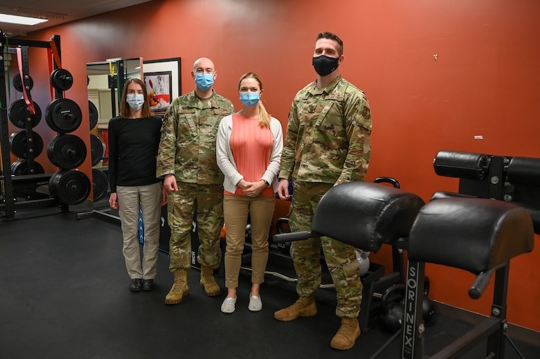 (Left to right) Dr. Lonni Scott, Tech. Sgt. David Curley, Dr. Ali Diiorio, and Capt. Brian Diiorio, Physical Therapy Flight Commander, are the physical therapists in the new physical therapy room at 75th Medical Group's clinic. (U.S. Air Force photo by Cynthia Griggs)
