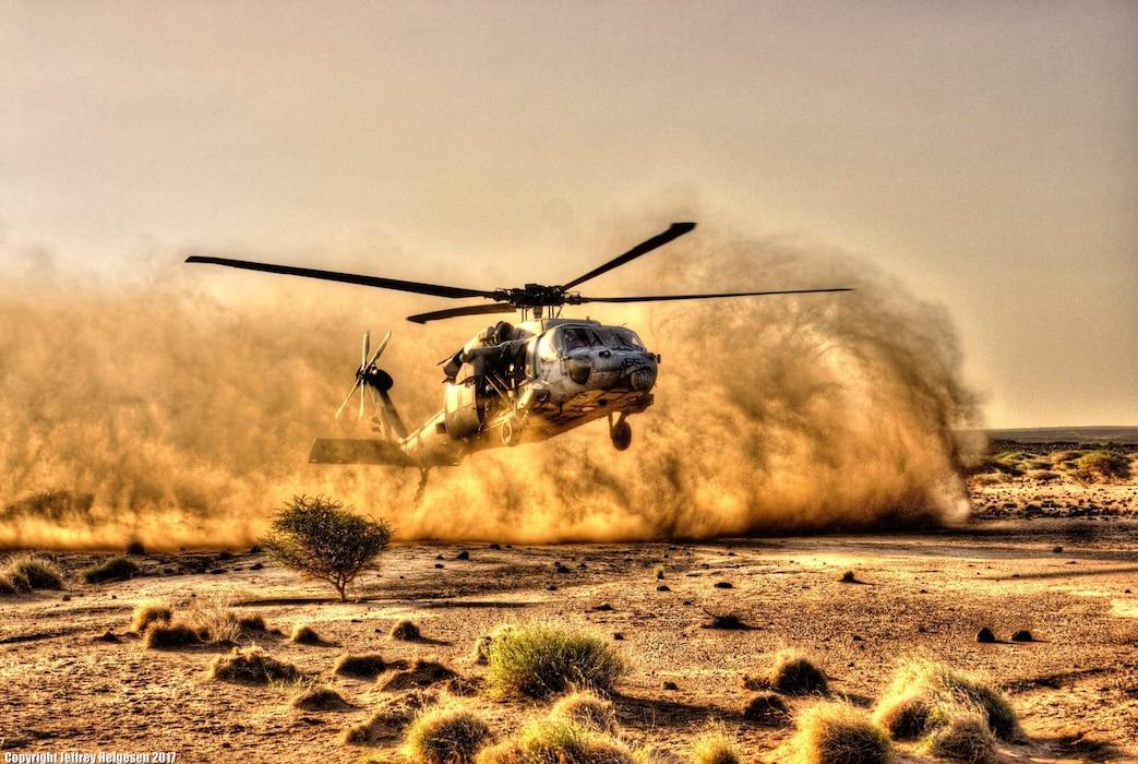 helo landing in desert