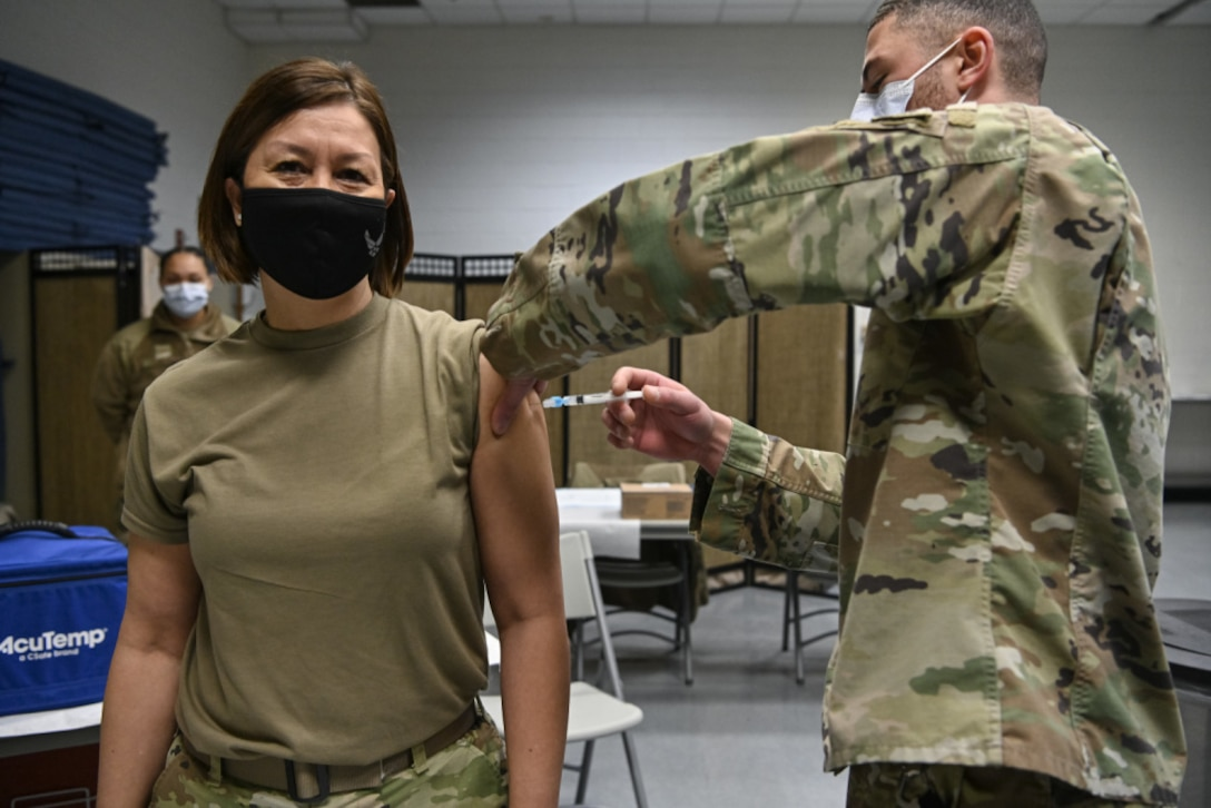 Chief Master Sgt. of the Air Force JoAnne S. Bass receives the COVID-19 vaccine from Senior Airman Aidan Herring, an allergy technician with 316th Medical Squadron, at Joint Base Anacostia-Bolling, Washington, D.C., Jan. 12, 2021. (U.S. Air Force photo by Eric Dietrich)