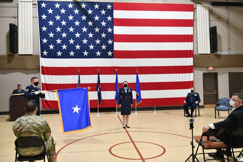 New York Air National Guard Brig.Gen. Denise Donnell stands at attention as her general officer's flag is unfurled during promotion ceremonies held on Wednesday, Jan. 6, 2021