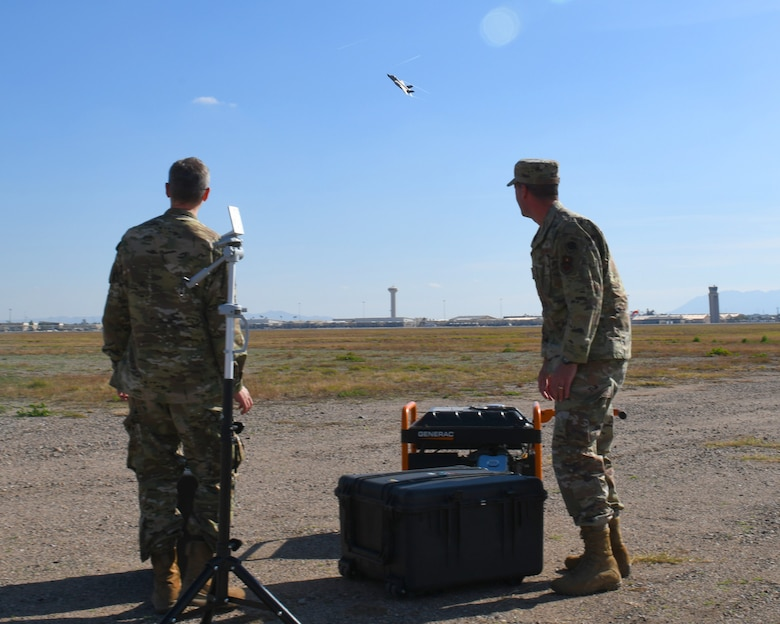 First Lt. Adam Treece, 56th Operations Support Squadron intelligence readiness chief, and Capt. David Coyle, 56th OSS weapons officer, test a prototype threat emitter system Jan. 17, 2020, at Luke Air Force Base, Ariz. Treece, Coyle and Wylie Standage Beier, Arizona State University electrical engineering PhD student, made the project 'Making Waves', to create a low-cost, mobile threat emitter system to be used in training for fifth-generation aircraft. The team is one of six finalists in the annual Spark Tank competition. (U.S. Air Force photo by Airman 1st Class Leala Marquez)