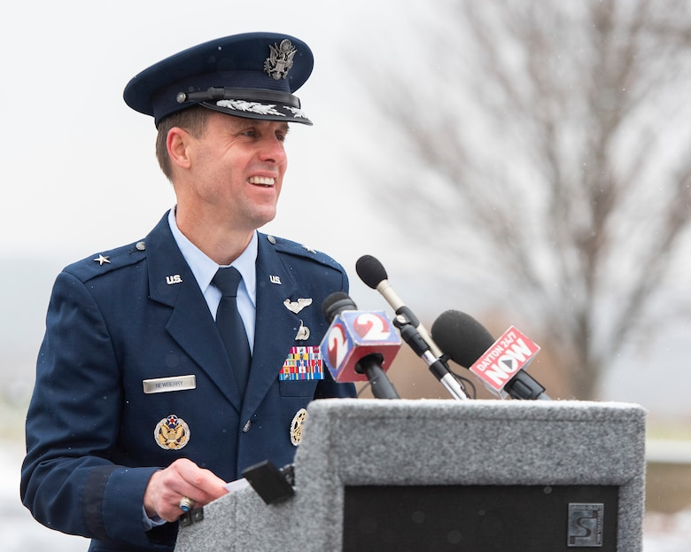 Brig. Gen. John Newberry, Air Force Life Cycle Management Center Bomber Directorate executive officer, is the guest speaker at the annual anniversary of first powered flight ceremony, Dec. 17, 2020, at the Wright Brothers Memorial on Wright-Patterson Air Force Base, Ohio. Newberry talked of how modern aircraft built on the technology developed by the Wright brothers. (U.S. Air Force photo by R.J. Oriez)