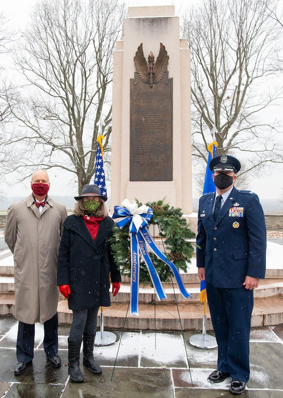 Amanda Wright Lane and Stephen Wright, great-grandniece and great-grandnephew of the Wright brothers, and Col. Patrick Miller, 88th Air Base Wing and installation commander, lay a wreath at the Wright Brothers Memorial Dec. 17, 2020, during the annual anniversary of the first flight ceremony held on Wright-Patterson Air Force Base, Ohio. The memorial overlooks Huffman Prairie where the Wright brothers taught themselves and others how to fly. (U.S. Air Force photo by R.J. Oriez)