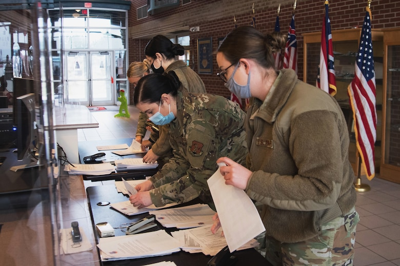 Image of Airmen working on paper work.