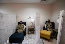 Staff Sgt. Kimberly and Staff Sgt. Laymisha, 432nd Security Forces Squadron Defenders, sit in seperate rooms seperated by a barrier to demonstrate privacy.