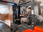 Members of the New York National Guard receive supplies build COVID-19 vaccination