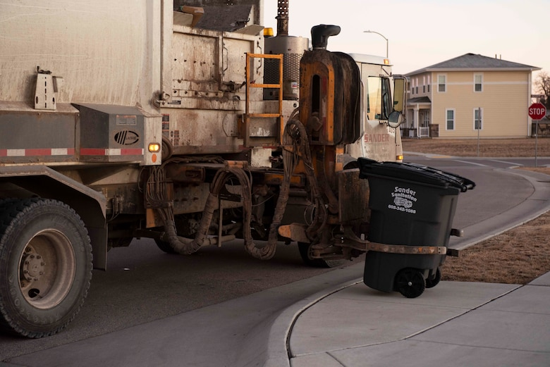 A trash can is lowered after being emptied at Ellsworth Air Force Base, S.D., Jan. 7, 2021.