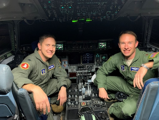 Lt. Col. James Freid-Studlo, 167th Operations Support Squadron commander, and Maj. Ben Mathias 167th Force Support Squadron commander, sit in the C-17 aircraft simulator at the 167th Airlift Wing, Martinsburg, W.Va. Freid-Studlo and Mathias both recently underwent pilot requalification training in the simulator after serving in other positions and not flying aircraft for an extended period of time.