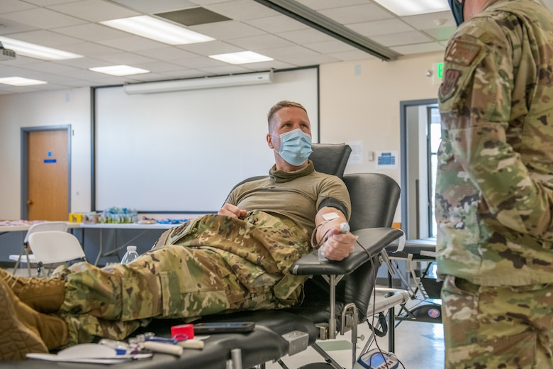 Col. Matthew Fritz, commander of the 419th Fighter Wing, speaks to Tech. Sgt. Jared Jacques, emergency management superintendent in the 419th Civil Engineer Squadron, while donating blood during the 419th FW Bloody Warrior Drive Jan. 9, 2021, at Hill Air Force Base, Utah.