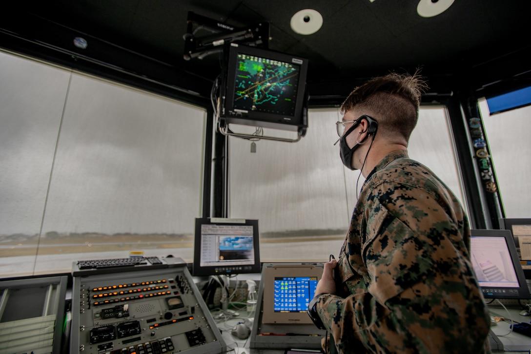 A U.S. Marine communicates with aircraft on MCAS Futenma, Japan, Jan. 7.