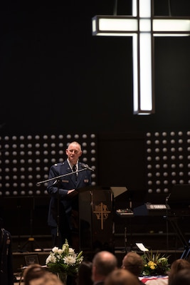 167th Airlift Wing Chaplain, Maj. Ronald Faith, speaks during the funeral service for Senior Airman Logan Young, a firefighter for the 167th Civil Engineering Squadron, at Victory Church, Winchester, Va., Jan. 7, 2021. Young died battling an off-base barn fire on Dec. 27, 2020.
