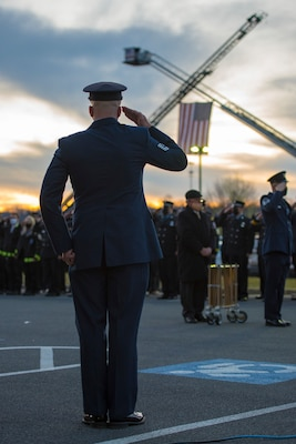 An Airman renders a salute at the conclusion of funeral services for Senior Airman Logan Young, a firefighter for the 167th Airlift Wing, at Victory Church, Winchester, Va., Jan. 7, 2021. Young died while battling an off-base barn fire Dec. 27, 2020.
