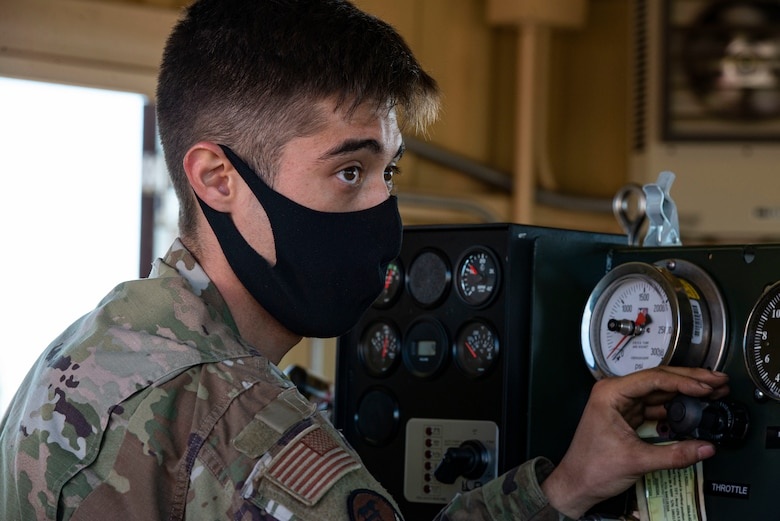 Airman Eric Christenson, 374th Civil Engineer Squadron electrical power productions shop apprentice, operates the newly installed flightline BAK-12 barrier, aircraft arresting system (AAS)