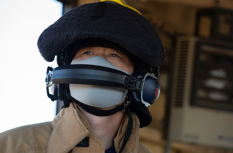 A fire fighter assigned to the 374th Civil Engineer Squadron fire department, operates the newly installed flightline BAK-12 barrier, aircraft arresting system (AAS)